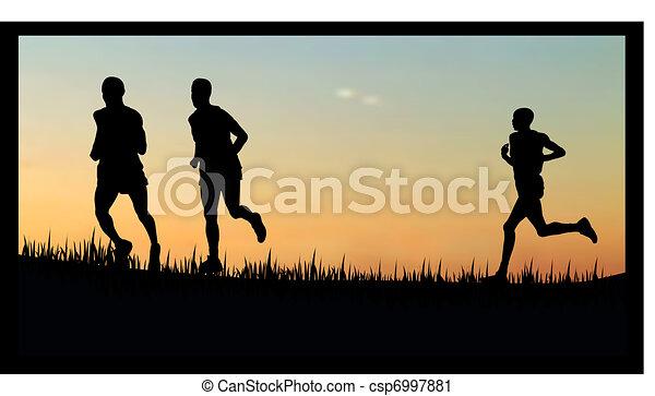 people running/jogging in the sunset/sunrise - csp6997881