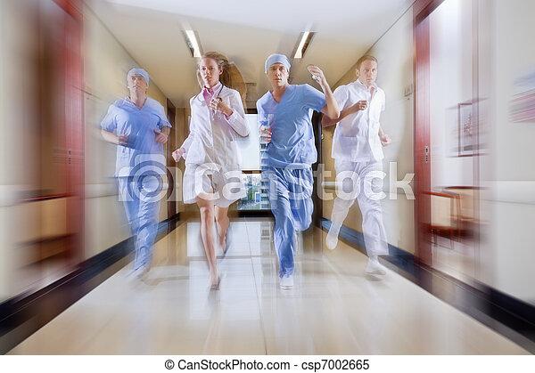 Surgeon and nurse running - csp7002665