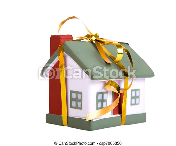 Toy small house with a gold bow. The concept of purchase and sale of habitation. - csp7005856