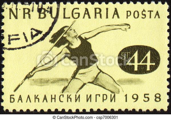 Javelin throwing on post stamp - csp7006301
