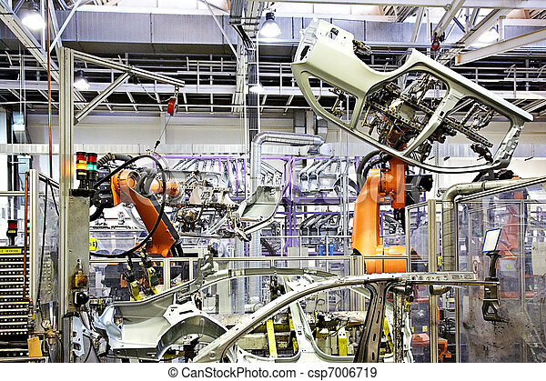 robotic arms in a car factory - csp7006719