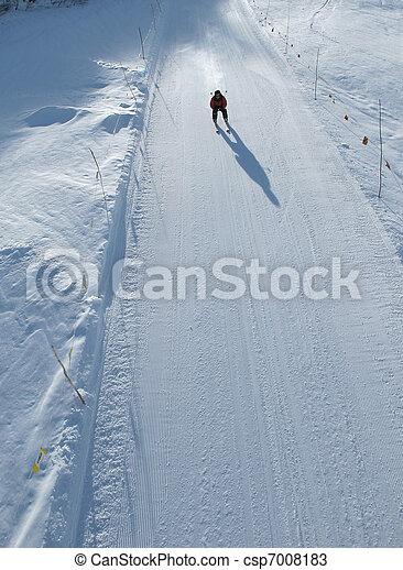 Downhill skier on fast piste - csp7008183