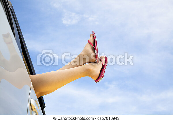young woman's legs and summer road trip concept - csp7010943