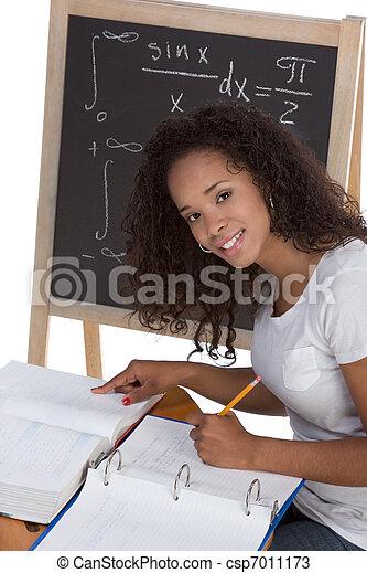 ethnic black college student woman studying math exam - csp7011173