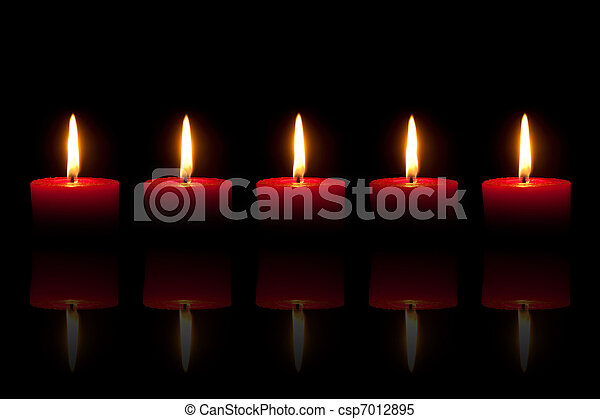 Five burning red candles in front of black background - csp7012895