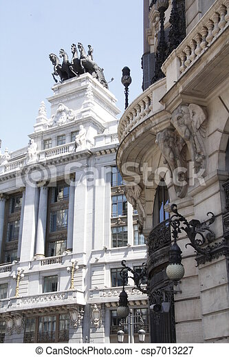 facade of a building on a chariot on the roof in Madrid Spain - csp7013227