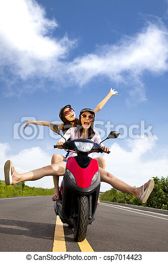 Happy young woman having summer trip on a scooter - csp7014423