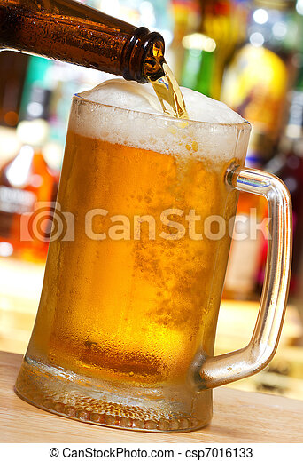 Beer pouring into mug - csp7016133