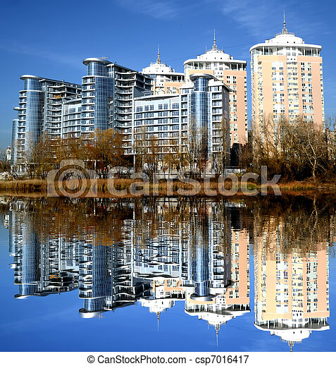 New building with reflection in lake in Kiev, Ukraine - csp7016417