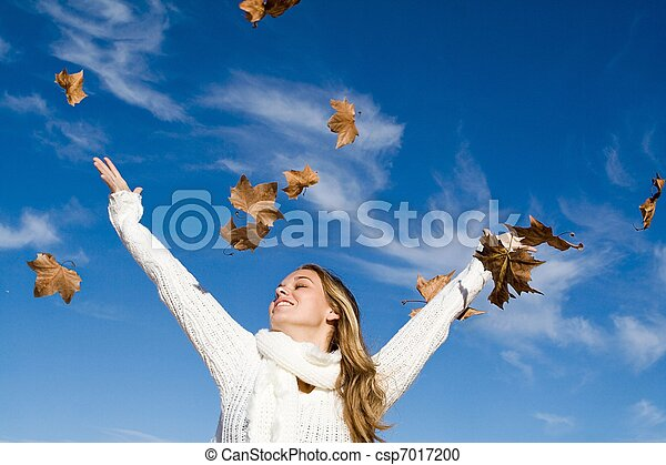 autumn woman arms raised in happiness - csp7017200