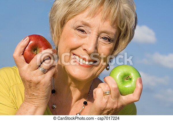 healthy senior woman with apples for health diet concept - csp7017224