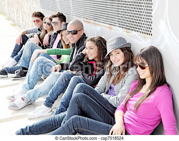 diverse group of teens or students on campus - csp7018524