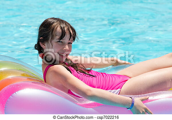 Girl relaxing on lilo in pool - csp7022216