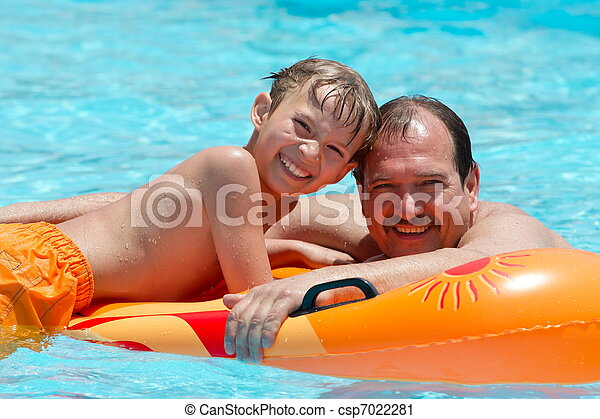 Father and son on water float  - csp7022281