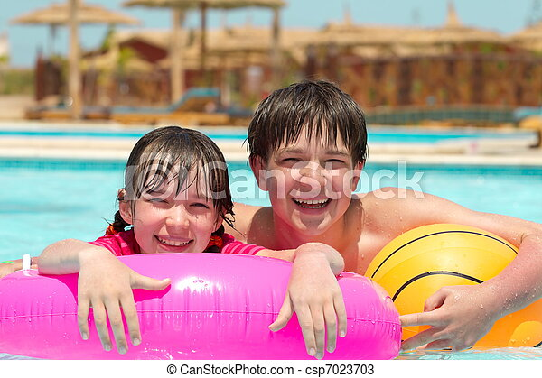 Sister and brother in pool  - csp7023703