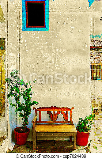 Antique bench against a wall. - csp7024439