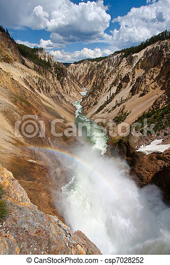 Rainbow over the waterfall in Yellowstone National Park, WY - csp7028252