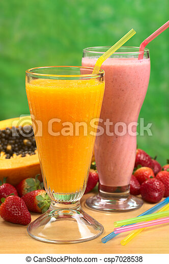 Papaya juice and strawberry milkshake with straws (Selective Focus, Focus on the straw in the papaya juice) - csp7028538