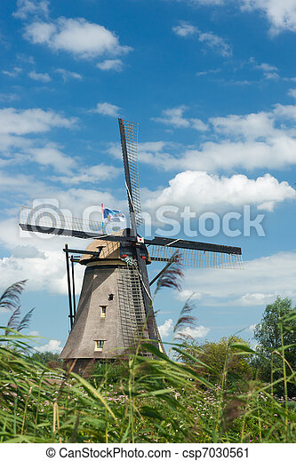 Windmill near Kinderdijk in NL (UN world heritage) - csp7030561