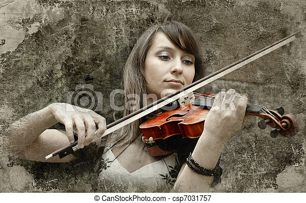 Beautiful female violinist playing violin on the grunge background - csp7031757