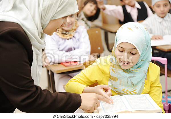 Education activities in classroom at school, happy children learning - csp7035794