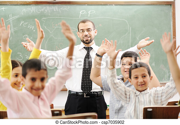 Education activities in classroom at school, happy children learning - csp7035902