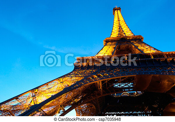 PARIS - JUNE 23 : Illuminated Eiffel tower at night sky June 23, 2010 in Paris. The Eiffel tower is one of the most recognizable landmarks in the world. - csp7035948
