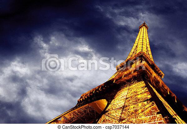 PARIS - JUNE 22 : Illuminated Eiffel tower at night sky June 22, 2010 in Paris. The Eiffel tower is one of the most recognizable landmarks in the world. - csp7037144