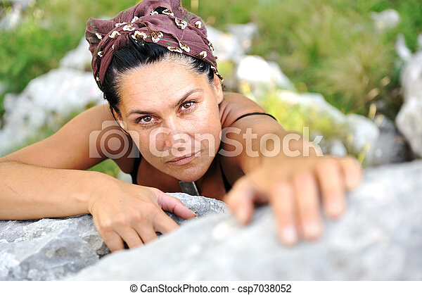 Female climbing rock on the top of mountain - csp7038052