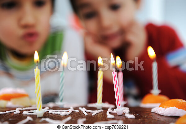 Two little boys blowing candles on cake, happy birthday party - csp7039221
