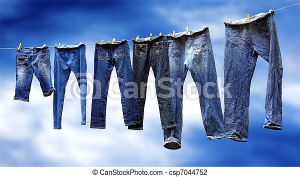 Jeans on a clothesline to dry - csp7044752