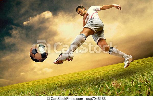 Happiness football player on field of olimpic stadium on sunrise sky - csp7048188