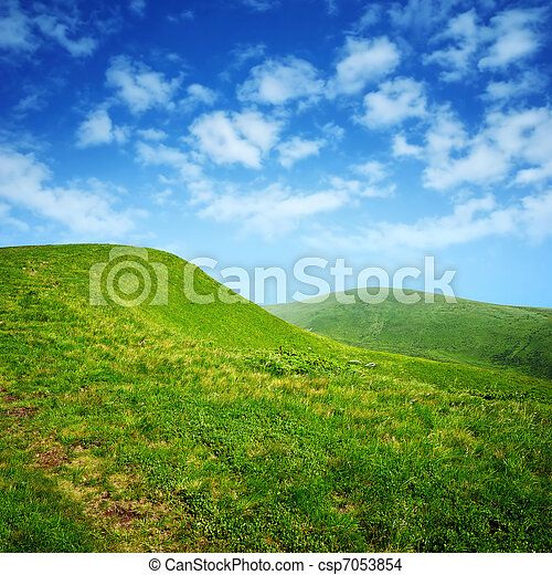 green hills and blue sky with clouds - csp7053854