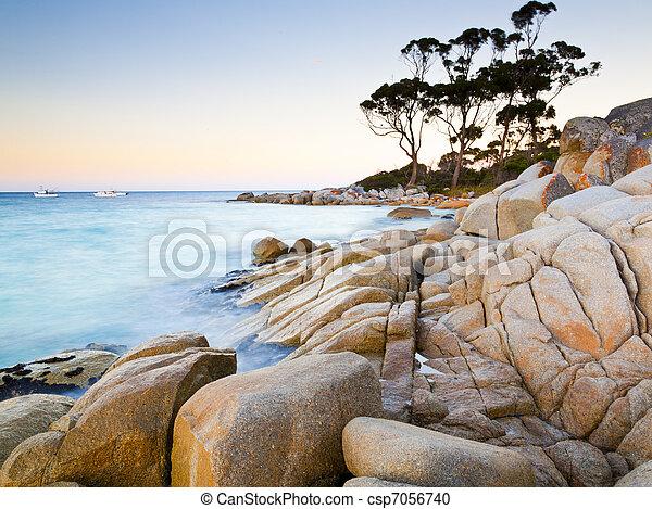 The rocky end of the beach at Binalong Bay Tasmania Australia - csp7056740