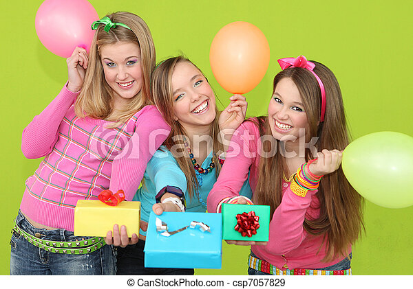 happy kids at birthday party giving wrapped gifts or presents - csp7057829