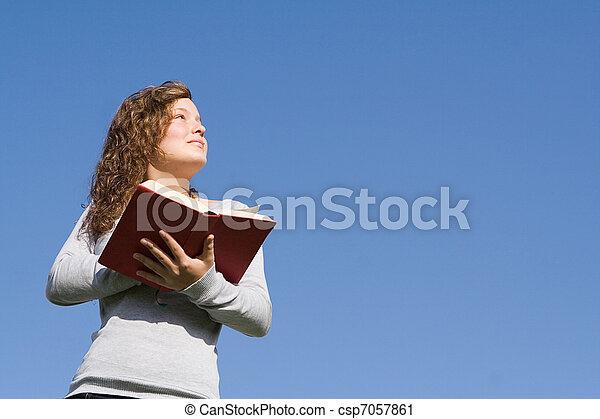 christian kid at bible camp reading gospel - csp7057861