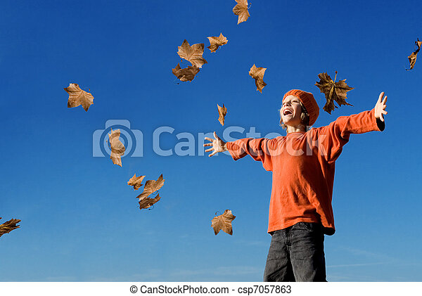 happy kid shouting or singing in autumn fall - csp7057863