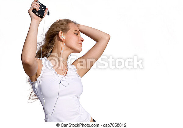 young woman or teen dancing to music from personal stereo - csp7058012