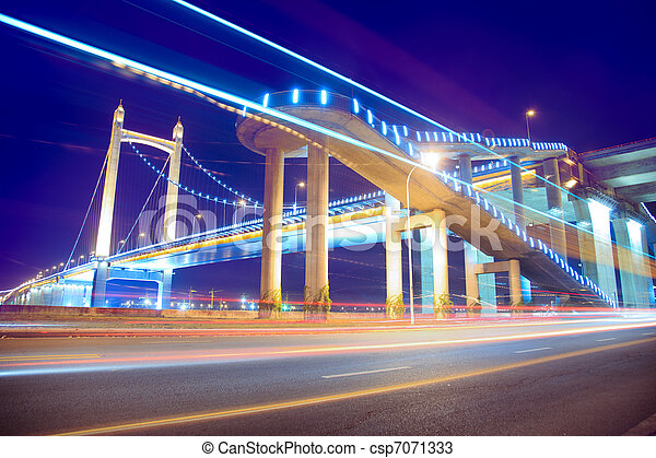 the light trails on the modern suspension bridge background - csp7071333