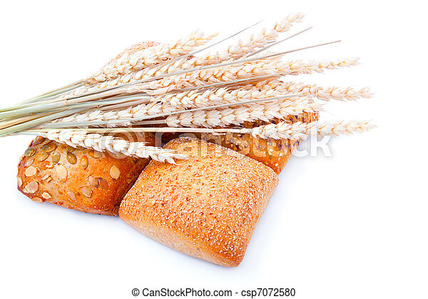 tasty baked with ears of wheat, isolated on a white background - csp7072580