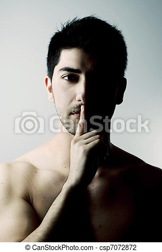 Sexy man in silence gesture - csp7072872