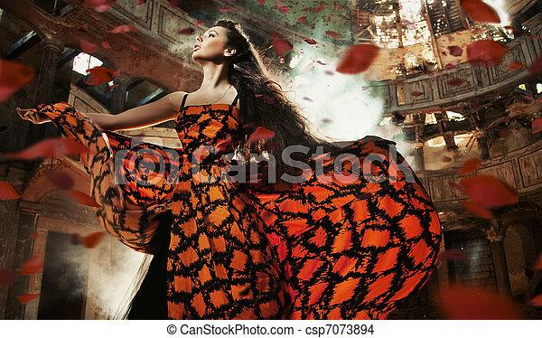 Beauty brunette among the roses petals - csp7073894