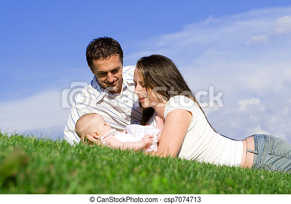 happy family parents and baby - csp7074713