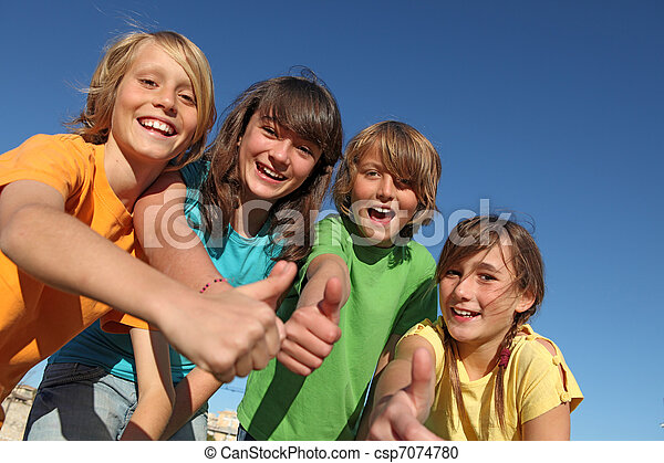 smiling group of kids or children with thumbs up - csp7074780