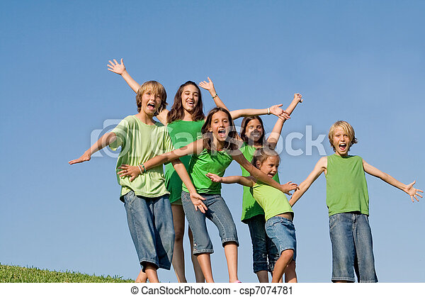 happy group of kids at summer camp singing or shouting - csp7074781