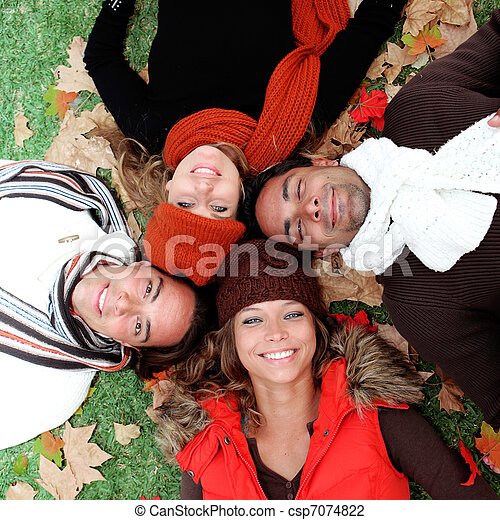 group of happy smiling young adults in autumn - csp7074822