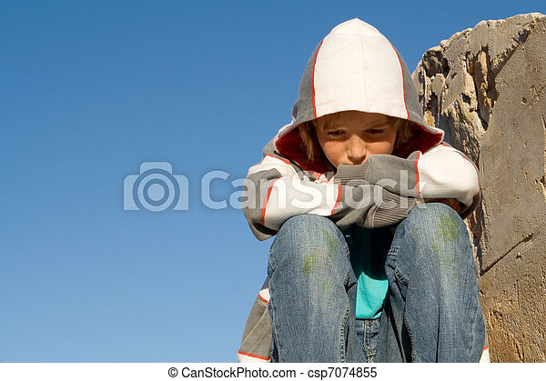 sad, lonely, unhappy , grieving, child sitting alone - csp7074855