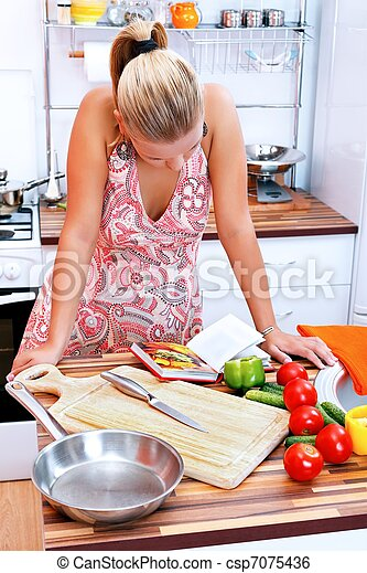 Woman with recipe book - csp7075436