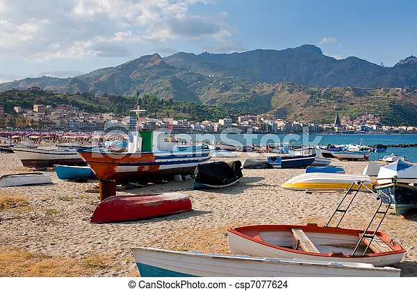 boats on  beach Giardini Naxos in summer day, Sicily - csp7077624