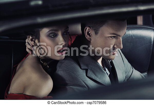 Portrait of a fashionable pair in a car - csp7079586